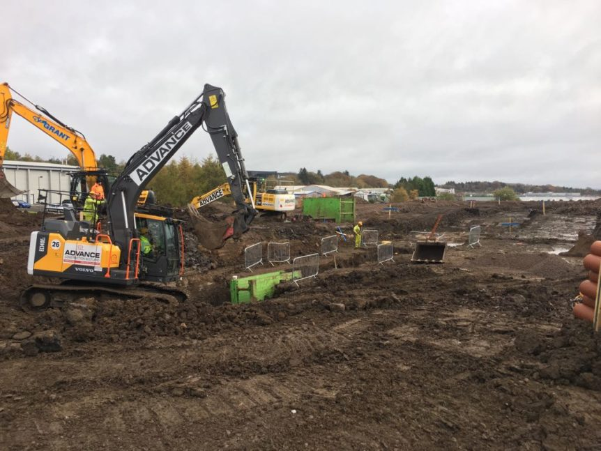 Digger on building site